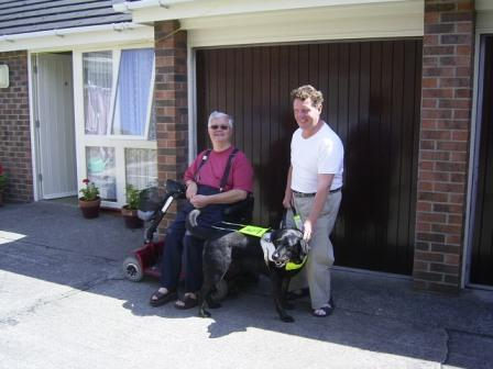 Philip, Gavin and his working guide dog Nathan